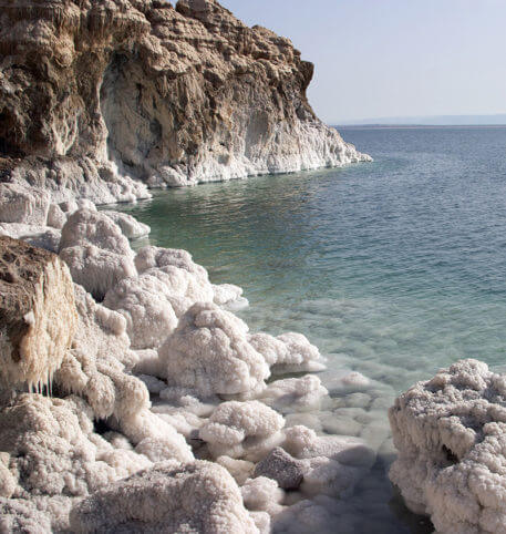 White rocks by the sea in Jordan, one of the holiday destinations you can go to with Homeric Tours.