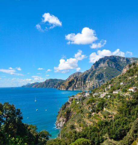 View of the Amalfi Coast in Italy. Crystal clear sea and green mountains.