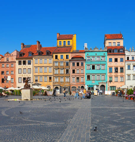 Colourful buildings in front of a square in Poland. Poland holidays and vacations package.