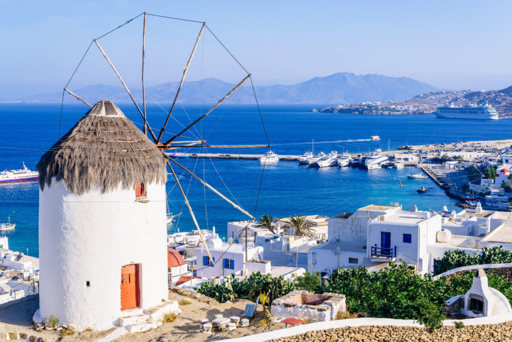 Windmill in Mykonos overlooking the Aegean Sea. Homeric Tours offer holiday packages in Greece.