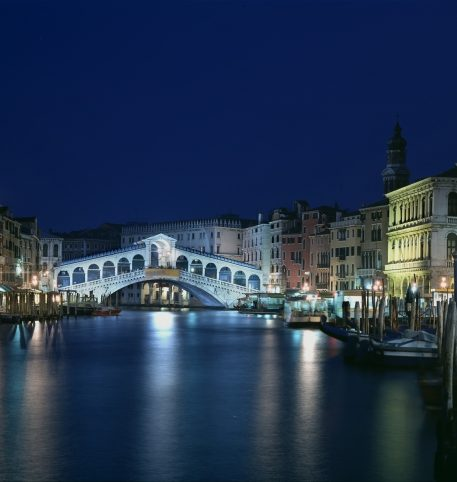 Night at a bridge in Venice, one of the most famous cities in Italy.