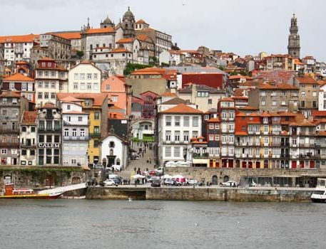 Houses with colourful walls and boats in the sea in Porto. Jewels of Portugal Porto holidays.