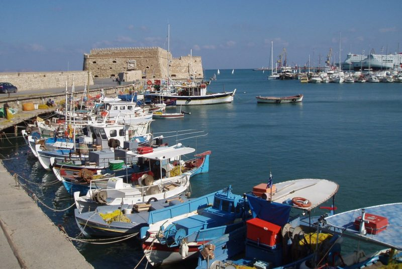 Fish boats and yachts at the port of Rhodes Town, one of the destinations Homeric Islander D package