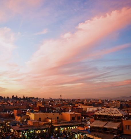 Panoramic view of a city in Morocco at dusk. Big South Kasbahs Morocco holidays.