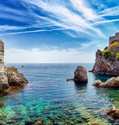 Old castle by the sea and impressive rocks. Discovery of Croatia holidays package.