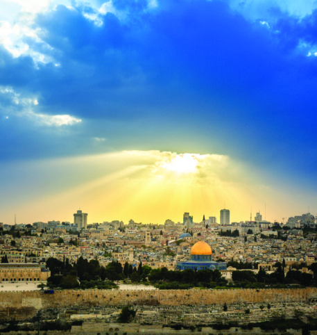 Solar rays in the sky of Jerusalem. Panoramic view of the city, one of the most popular destinations
